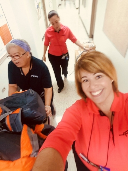 Photo: University of Puerto Rico staff transporting backpacks