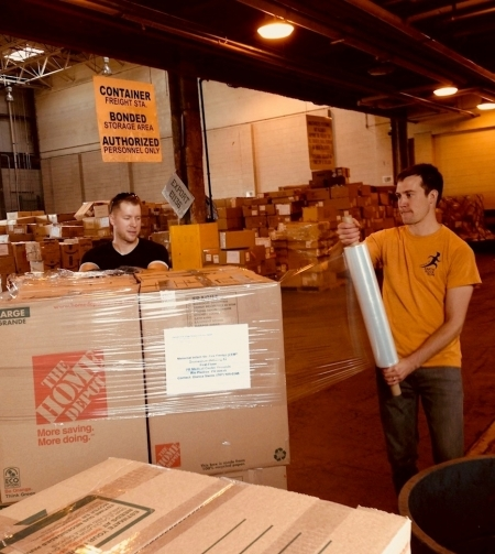 Photo: Brad and Erik wrapping boxes